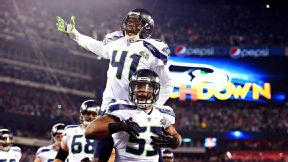 Though Super Bowl MVP Malcolm Smith, bottom, and the Seahawks ran away with the title, a record 111.5 million tuned in to watch Fox's telecast.