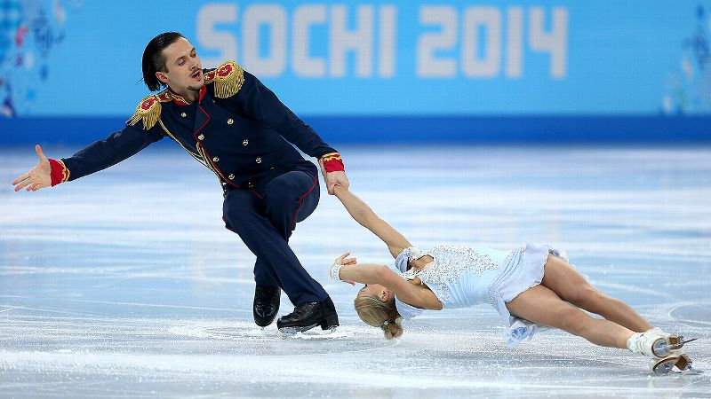 Russian pair Tatiana Volosozhar and Maxim Trankov received a standing ovation from the crowd after their record-setting performance.