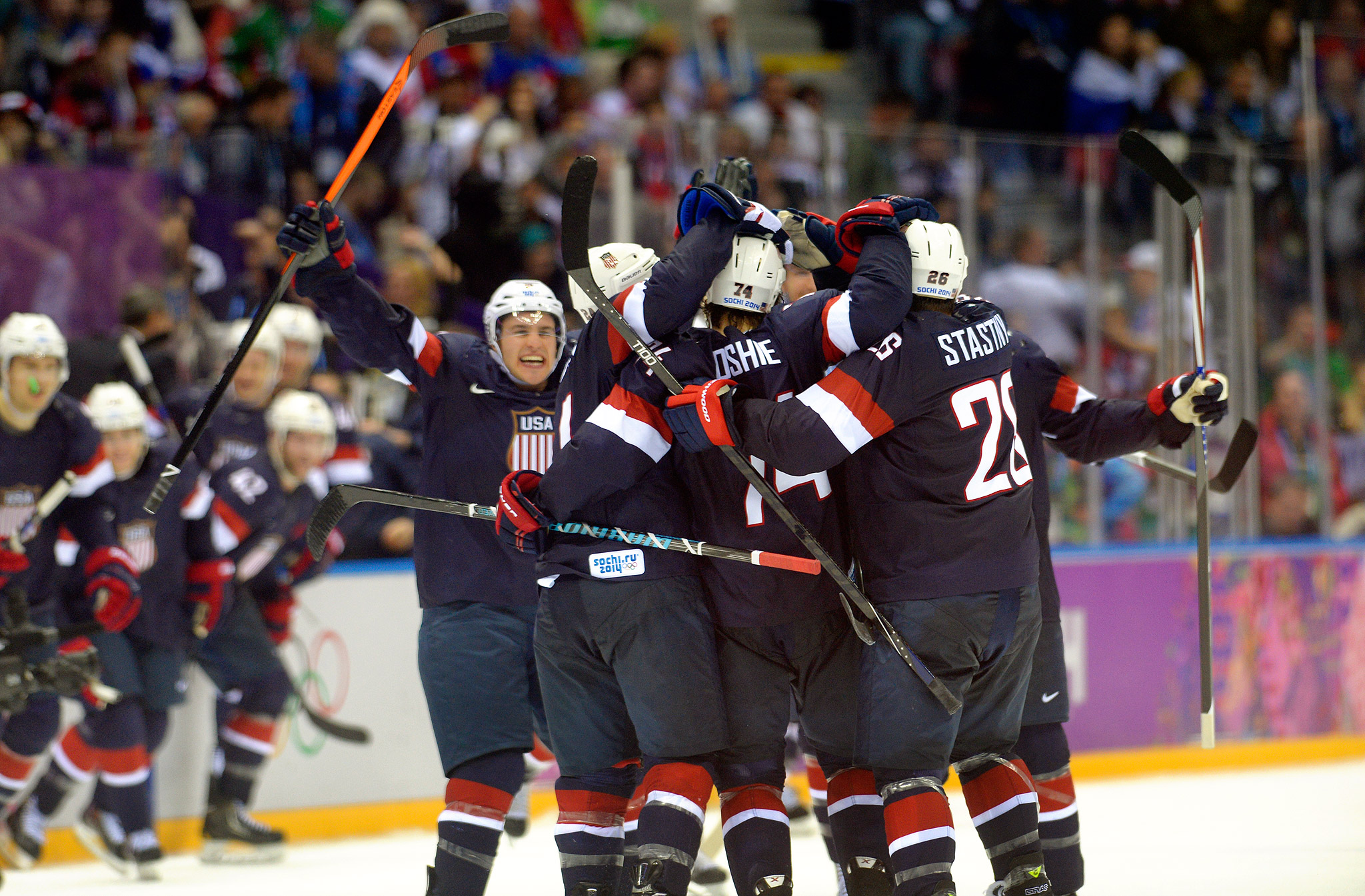 US Hockey Team celebrates shootout win over Russia