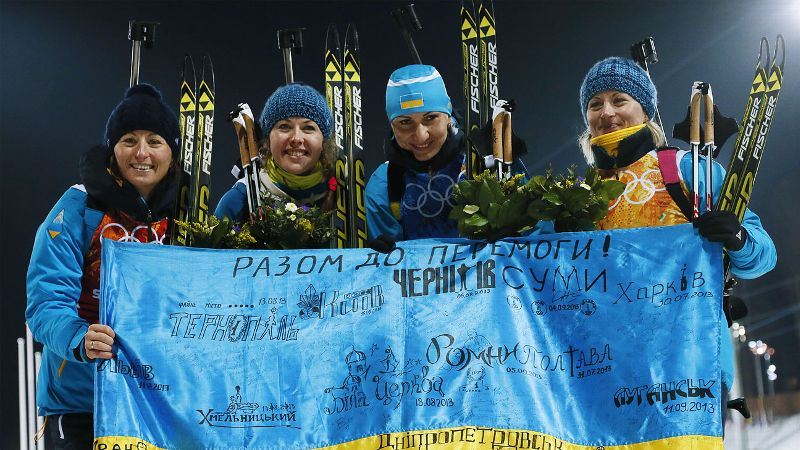 The women's 4x6-kilometer biathlon relay team gave Ukraine something to smile about, and Parliament paused to salute. After days of deadly anti-government protests, and as government and opposition leaders worked on a political solution to the months-long crisis, the four women won Ukraine's first Winter Olympics gold medal in two decades. Twins Vita and Valj Semerenko combined with Juliya Dzhyma and Olena Pidhrushna to win the last women's biathlon event at Sochi. There were tears, and then there were smiles. When I came to the podium I cried, and tried to hide it behind the skis, Valj Semerenko said. It was not only my tears, but the tears of the whole Ukraine. i(Photo: AP)/i