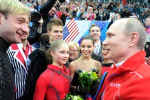 Russian president Vladimir Putin made the rounds during the Sochi Olympics, including the team figure skating event, where Evgeni Plushenko and Russia won gold.