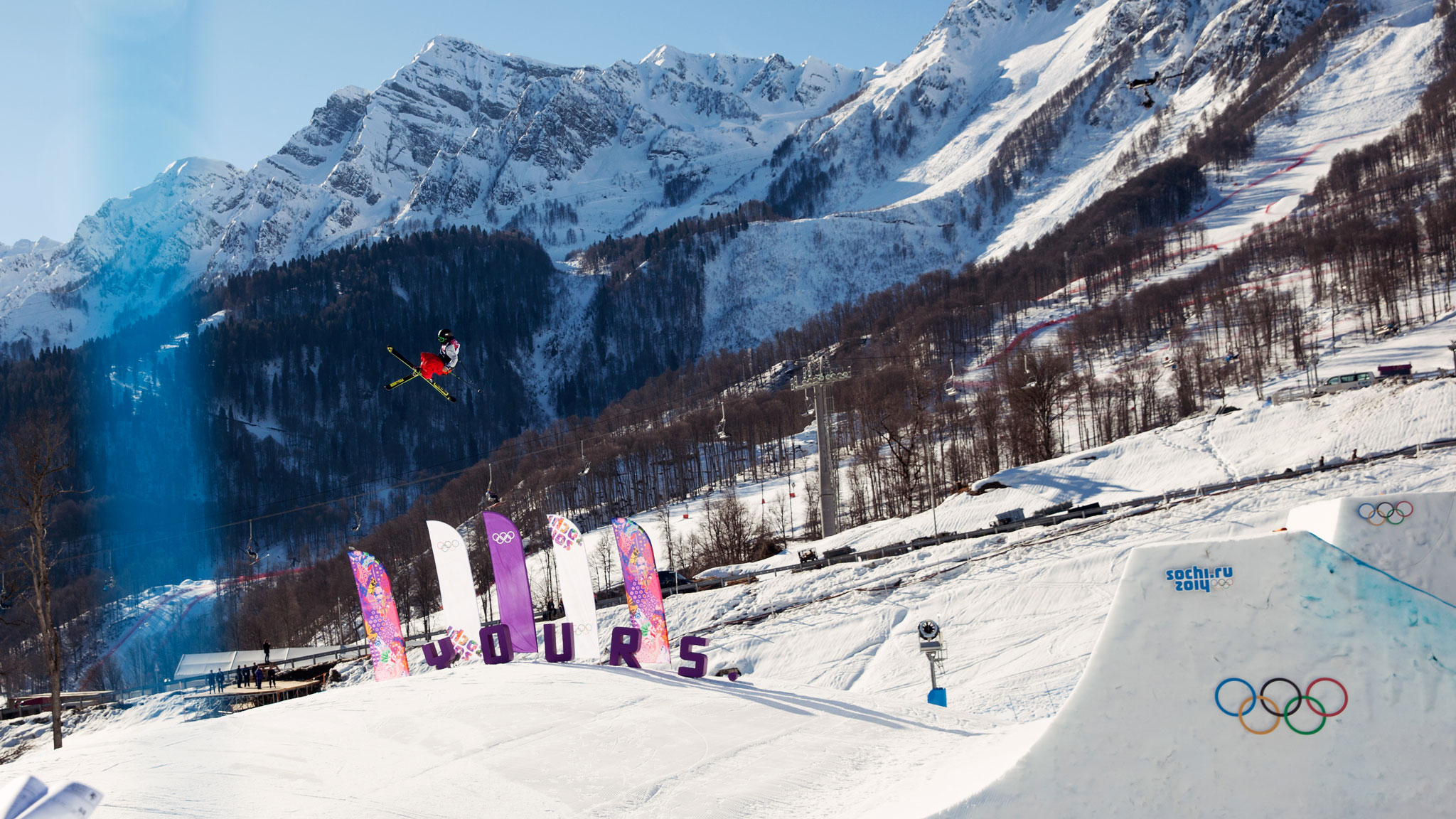 Joss Christensen skiing to victory in the inaugural slopestyle contest at the Olympic Games.