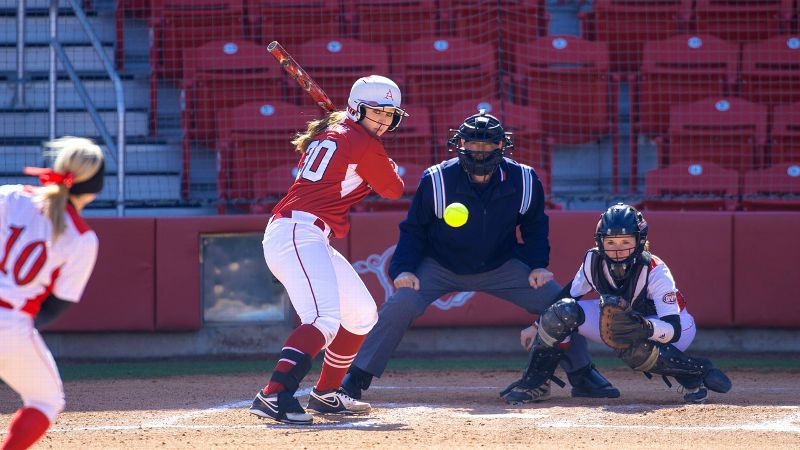 Arkansas' Devon Wallace is on a record-setting pace for walks, but she also knows what to do when a pitch is over the plate.
