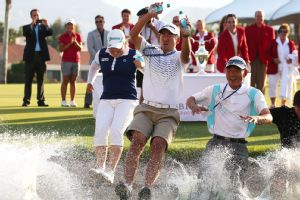 Inbee Park, left, took the traditional leap into Poppie's Pond after winning the Kraft Nabisco Championship last year.