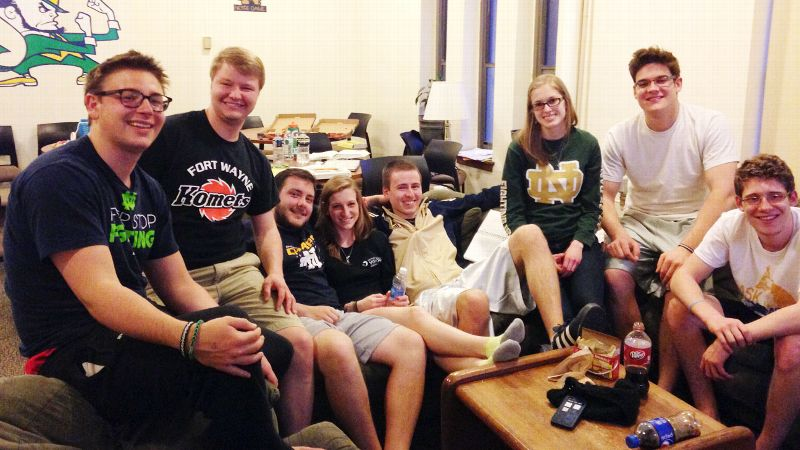 Samantha Zuba, third from right, watches the Notre Dame-Maryland game Sunday night with some friends in a student lounge.