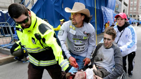 Carlos Arredondo (center) rushed to the aid of Jeff Bauman, who lost both legs in the blast.