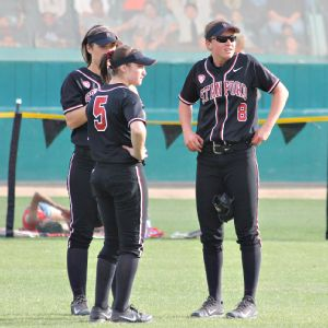 One of the things Bessie Noll, right, likes about softball is camaraderie she feels playing with 18 other girls.