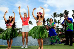 Michelle Wie performs the hula dance after winning in her native Hawaii on Saturday.