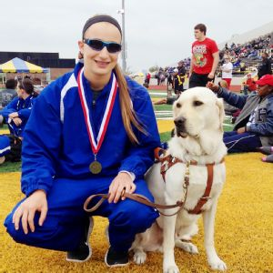 Charlotte Brown poses with Vador and her gold medal from last week's area meet.