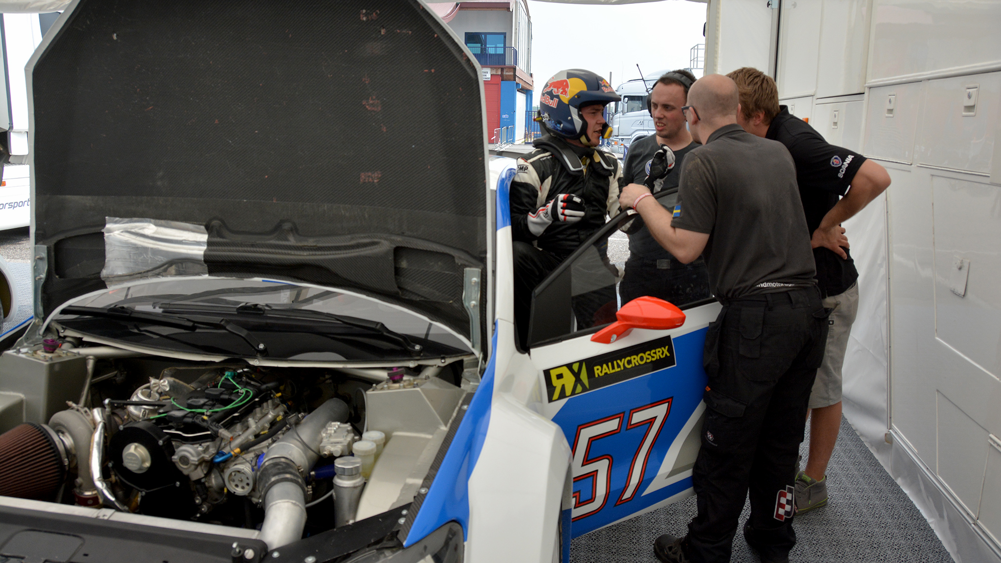 Heikkinen is quick to credit his crew for his rally racing success. Here, Heikkinen consults with his crew before the World RX season opener in Portugal.