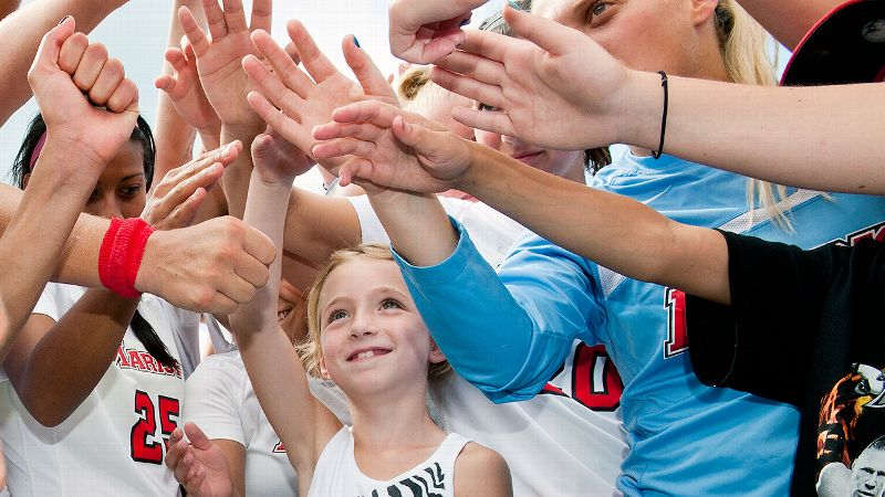 Nine-year-old Jaimie Ferretti, who was diagnosed with a brain tumor two a half years ago, has a loving circle of friends in the Marist women's soccer team.
