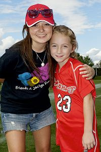 Jaimie Ferretti with Jaclyn Murphy, who started Friends of Jaclyn with her father in 2005 after she found support from the Northwestern women's lacrosse team while fighting her own brain tumor.