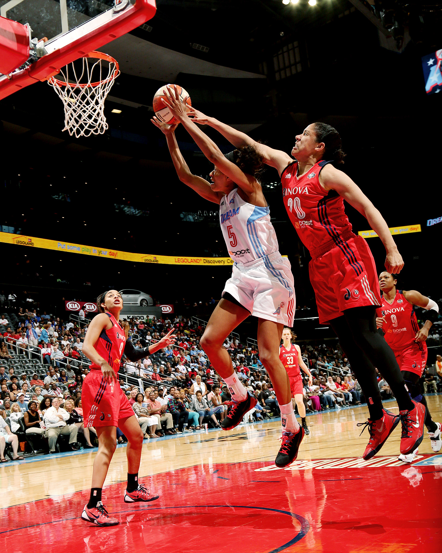 The Atlanta Dream's Jasmine Thomas grabs a rebound against the Washington Mystics during their WNBA game at Philips Arena in Georgia.