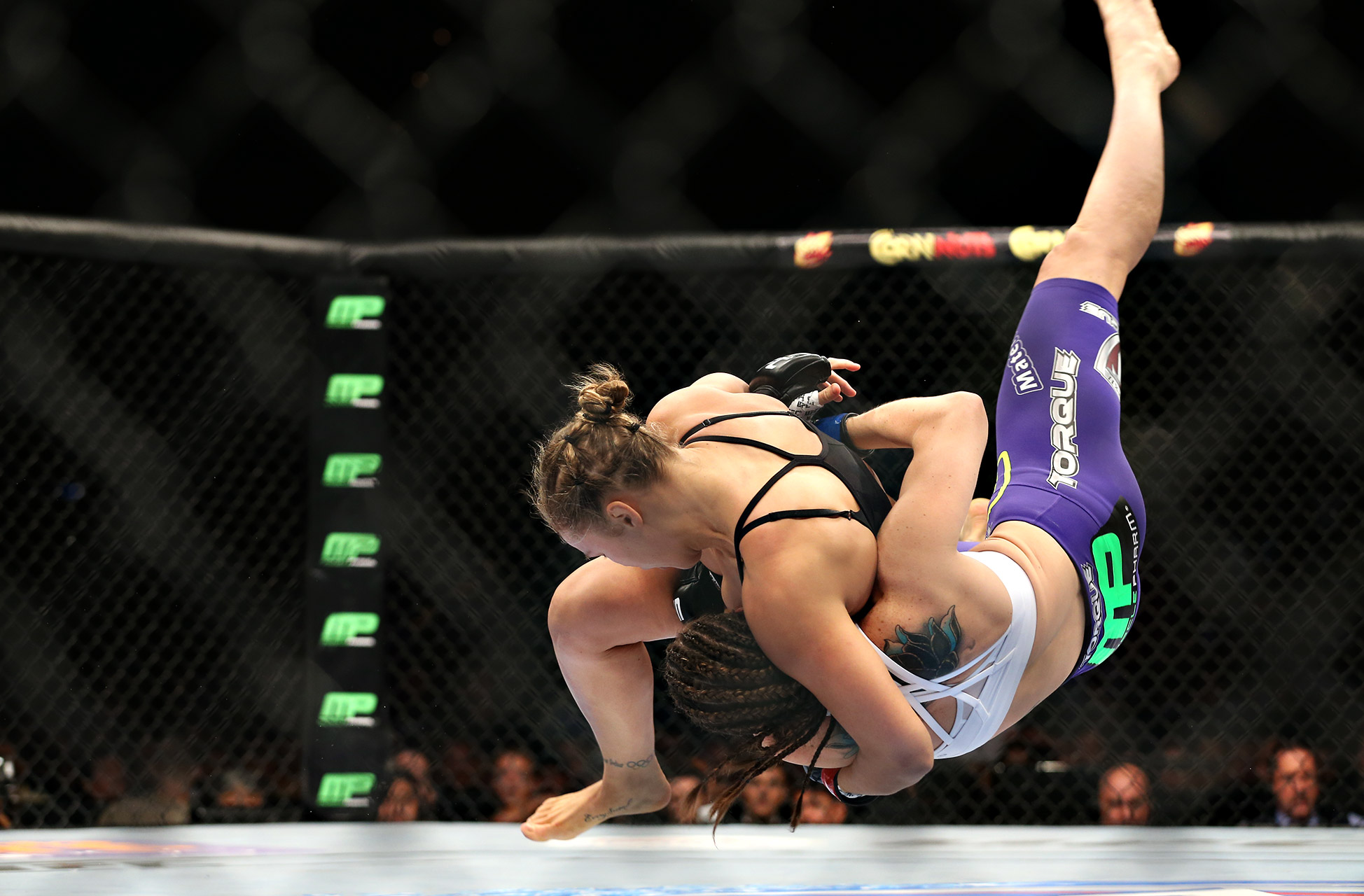 Ronda Rousey takes down Alexis Davis during their co-feature bout at UFC 175. Rousey (10-0) finished her second consecutive fight via knockout, needing only 16 seconds to put away Davis.