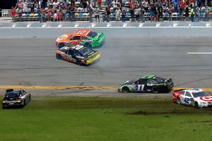Avoiding two massive accidents, Danica Patrick finished eighth Sunday in the rain-shortened Coke Zero 400.