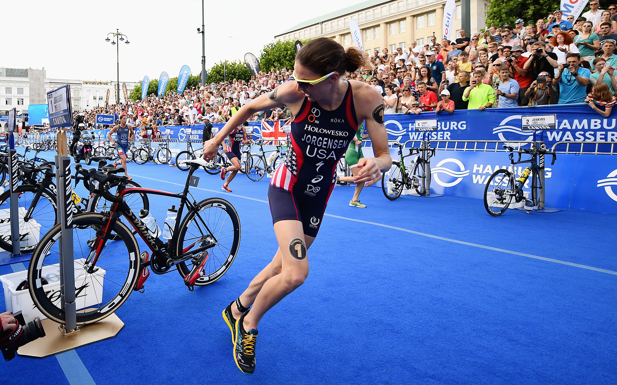 Gwen Jorgensen of the United States runs in the women's ITU World Triathlon sprint event in Hamburg, Germany.