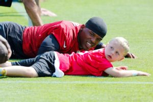 Cam Newton and George Gring, 6, go through their paces at Panthers practice.