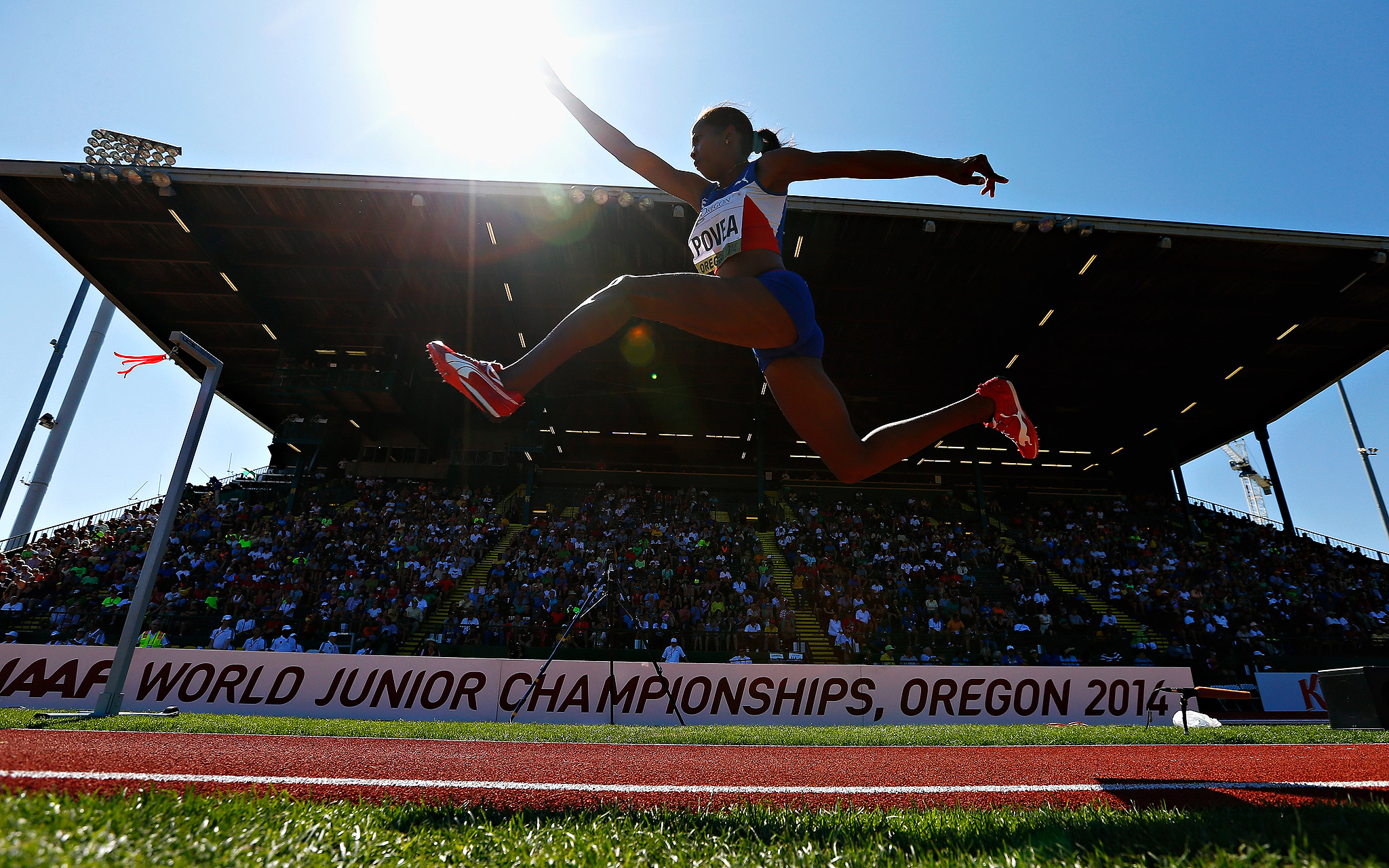 Cuba's Liadagmis Povea competes in the women's triple jump during Day 5 of the IAAF junior world championships at Hayward Field in Eugene, Oregon.