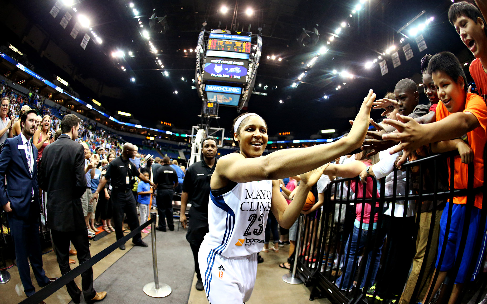 The Minnesota Lynx's Maya Moore celebrates with fans after a WNBA game against the Atlanta Dream at Target Center in Minneapolis. Moore scored 48 points, the second most ever in the league, to help the Lynx win 112-108 in double-overtime.