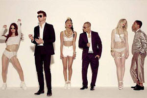 Pharrell Williams got the love, Robin Thicke got denounced -- for doing the same thing.