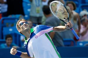 Tommy Robredo celebrates his upset win over top-seeded Novak Djokovic on Thursday.