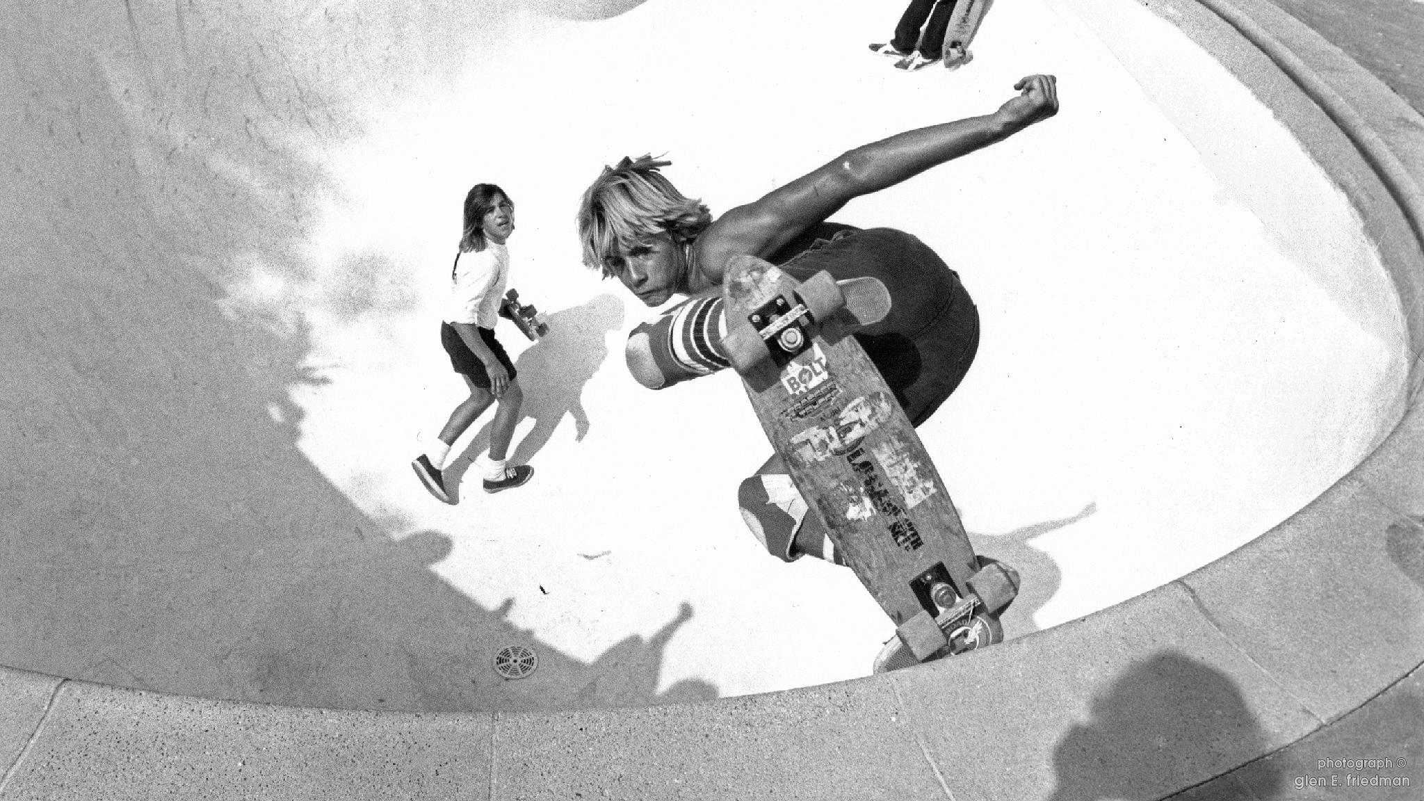 Adams skates a backyard pool in West Los Angeles in 1976. Fellow Zephyr team rider Paul Constantineau looks on from the bottom of the pool.