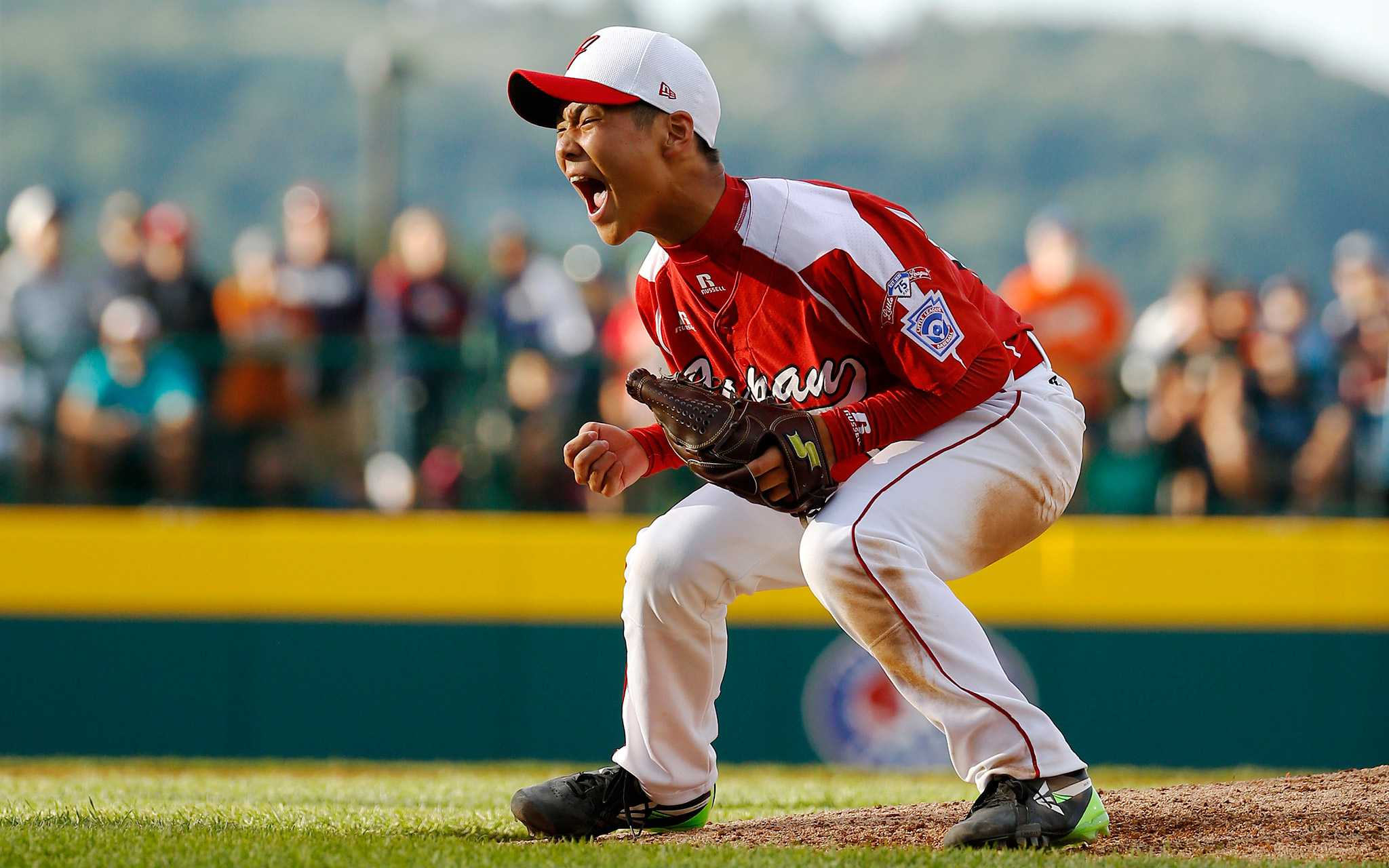 Takuma Takahashi of Tokyo, Japan, was thrilled after striking out Venezuela's Asnaldo Caicedo for the final out of his team's 1-0 win at the Little League World Series.
