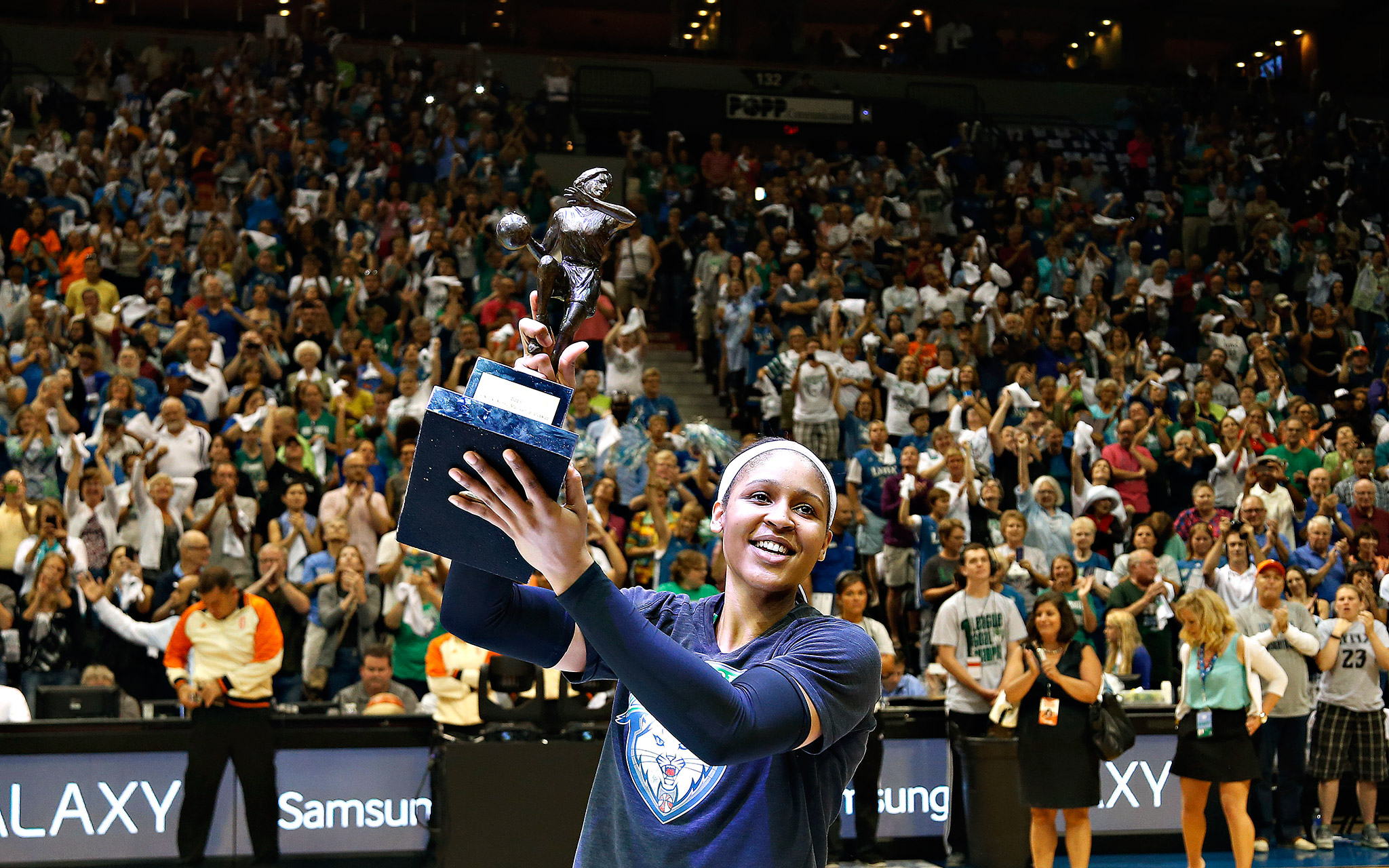 Minnesota Lynx forward Maya Moore celebrates with fans after receiving her WNBA MVP award prior to Game 1 of the Western Conference semifinals against the San Antonio Stars in Minneapolis.