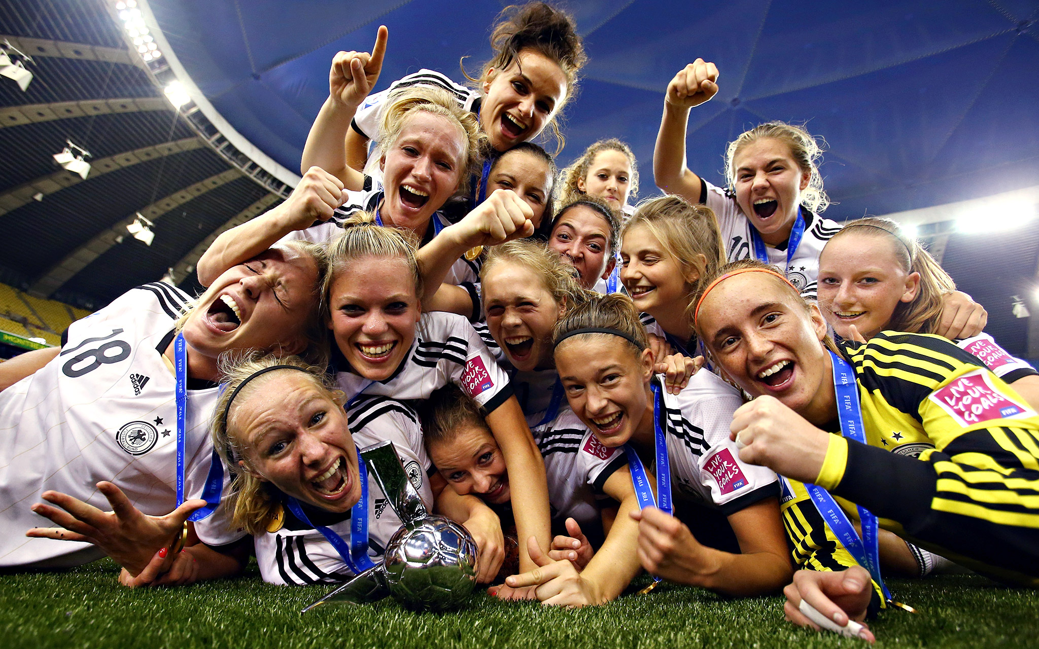 Party! Players from Germany let loose after beating Nigeria 1-0 in the eighth minute of extra time to win the U-20 Women's World Cup on Sunday in Montreal.