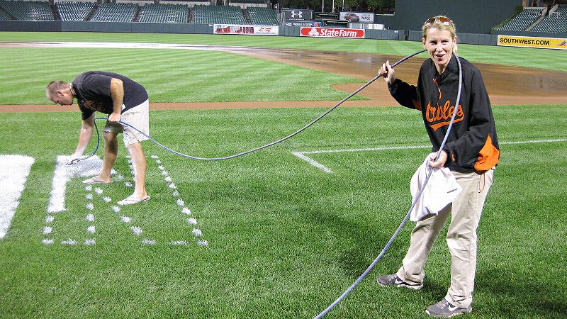 Baltimore's Nicole McFadyen is one of only two women groundskeepers in MLB. And even though she's in charge, McFadyen isn't afraid to dive in and hold a spray-paint hose herself.