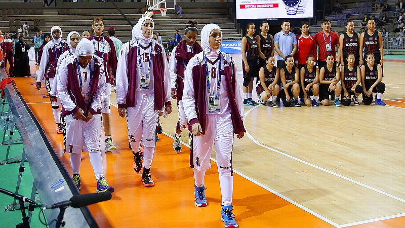 The Qatar women's basketball team walked off the court in protest after being told they could not play while wearing hijabs.