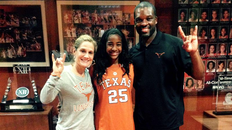Deja Kelly, a 5-foot-8 combo guard, feels right at home with Texas coach Karen Aston and associate coach Travis Mays.