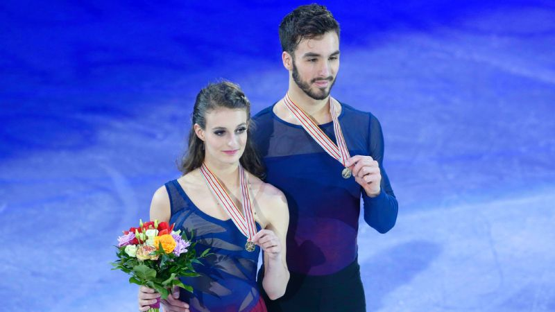 Gabriella Papadakis and Guillaume Cizeron moved ahead of Anna Cappellini and Luca Lanotte in the short dance to retain their ice dance title at the European figure skating championships.