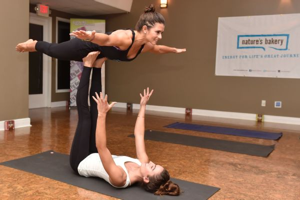Patrick gets an assist from yoga expert Morgan DeYoung during a class with members of the media before the Daytona 500.