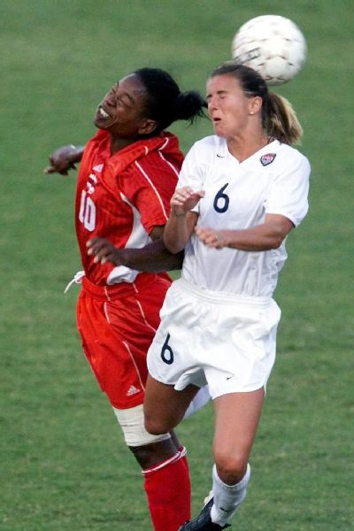 Chastain (left) and Canada's Charmaine Hooper head the ball during their semifinal match in the Women's Gold Cup Tournament game in Louisville, Kentucky, in July 2000.