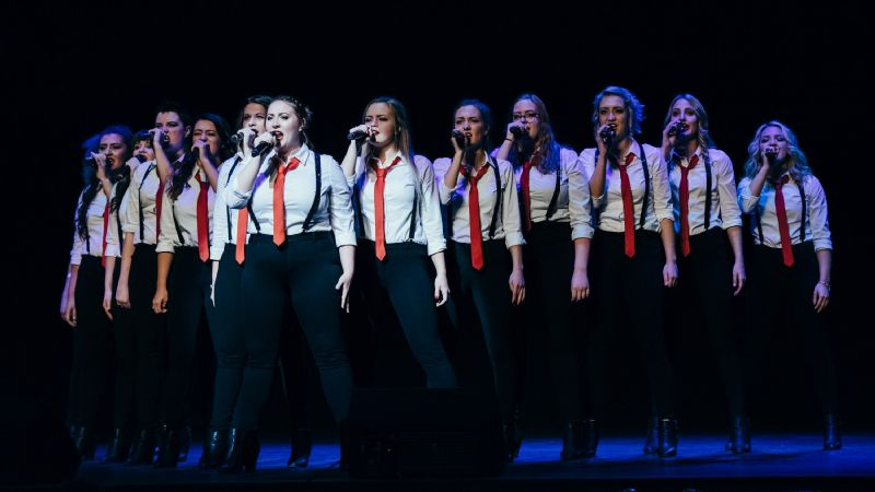 Divisi belts Start a Riot by Jetta, led by soloist and music director Caitlin Byers, at the ICCA finals in New York City, April 2016.
