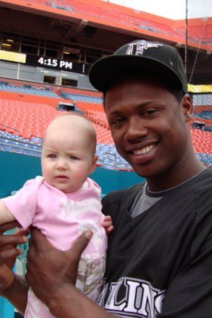 Hanley Ramirez holds Hewitt's daughter, Lila, in 2009. The Marlins were cool about letting me bring my kids to work every once in a while, she says.