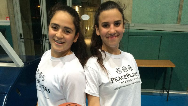 Ofir, left, is a Jewish Israeli, and Malak is a Muslim Palestinian. Without their basketball team, they would most likely have spent a lifetime living next to each other but never meeting.