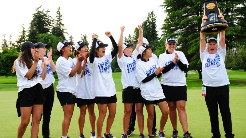 Members of the Washington Huskies golf team celebrate as head coach Mary Lou Mulflur hoists trophy after winning the Division I championship against Stanford on May 25.