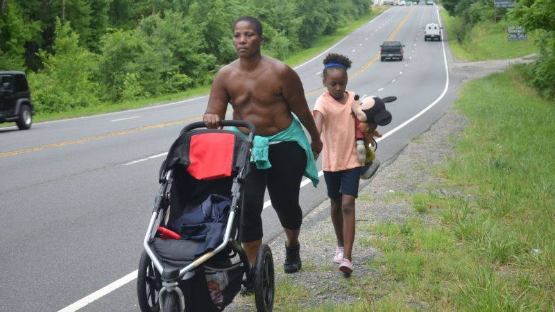 Paulette Leaphart and her daughter Madeline walk through Spotsylvania County, Virginia, on the shoulder of Jefferson Davis Highway, on June 23.