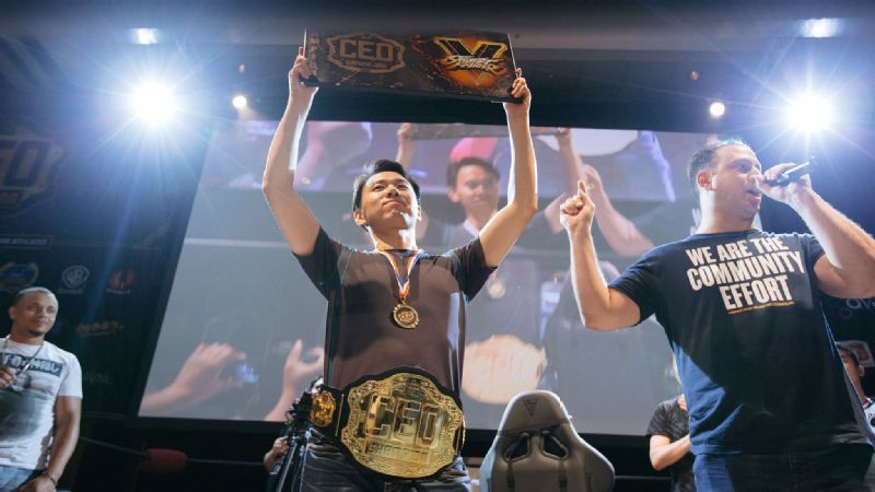 Hajime Tokido Taniguchi, formerly of Mad Catz, raises his CEO 2016 championship trophy. He has since moved to Echo Fox.