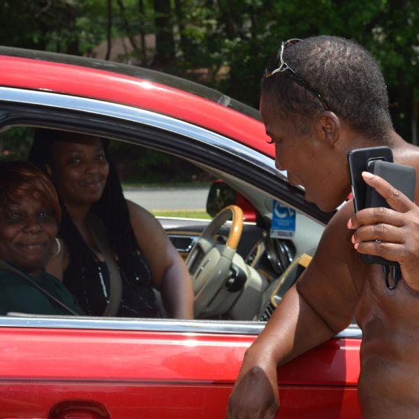 Taraysha and Sarah Woodall stop Leaphart outside of Falmouth, Virginia, on June 25 to see if she needs a ride.