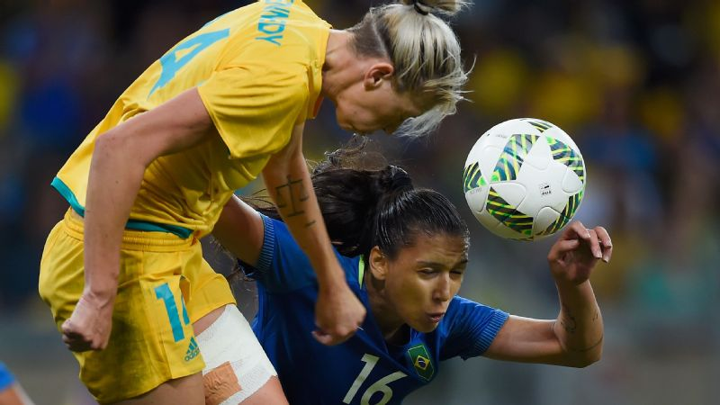 Australia's Alanna Kennedy competes with Beatriz of Brazil during the women's quarterfinal.
