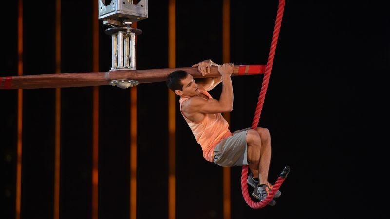 Casey Suchocki attempts the Propeller Bar in American Ninja Warrior national finals.