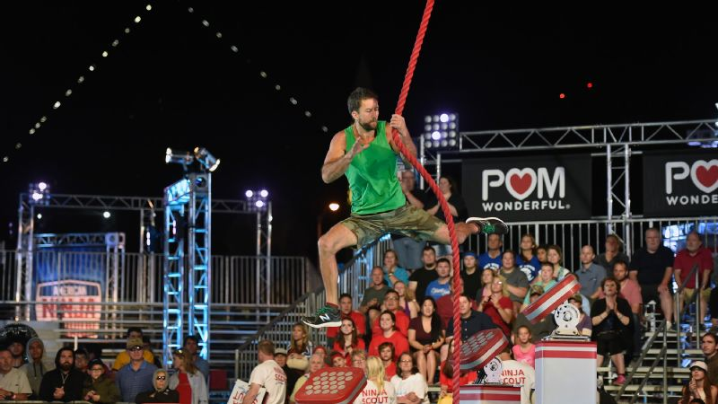 Liam Buell jumps to the rope on Sonic Curve in American Ninja Warrior national finals.