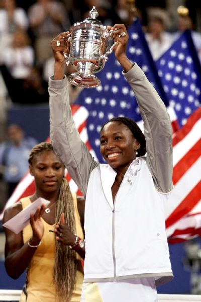 Venus Williams lifting the US Open trophy after defeating her sister Serena in 2001.