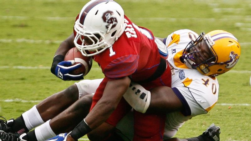 Benedict's Devin Gainer wrestles down South Carolina State running back Justin Taylor in the first quarter of the Palmetto Capital City Classic at Williams-Brice Stadium in Columbia, South Carolina, on Sept. 21, 2013.