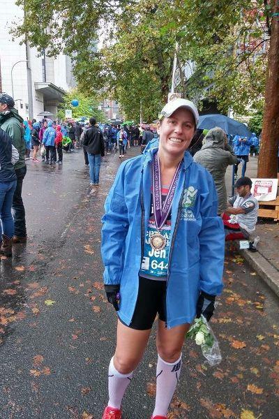 Jen Miller at the finish line of the Portland Marathon.