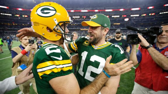 Green Bay Packers quarterback Aaron Rodgers (12) celebrates with kicker Mason Crosby (2)
