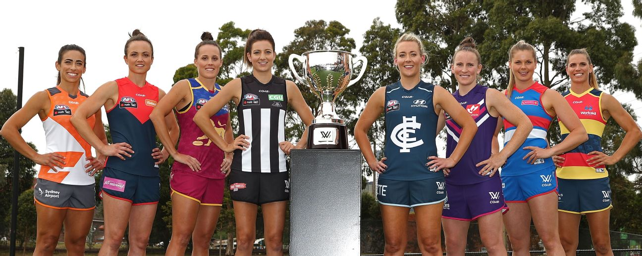 Amanda Farrugia, Daisy Pearce, Emma Zielke, Steph Chiocci, Lauren Arnell, Kara Donnellan, Katie Brennan and Chelsea Randall pose with the AFLW premiership trophy.